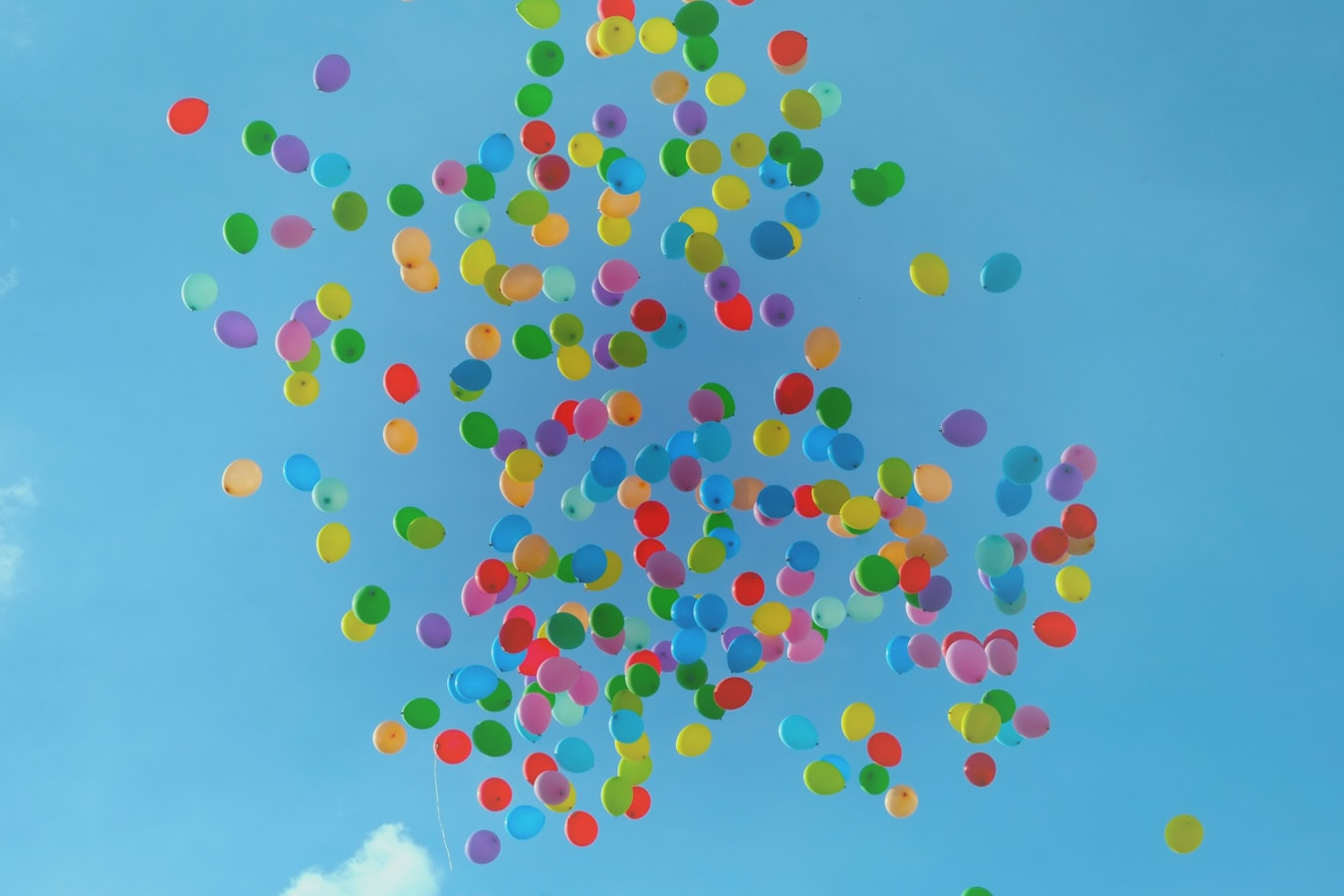 You can find some happy balloon images on Unsplash, like the one inserted below.